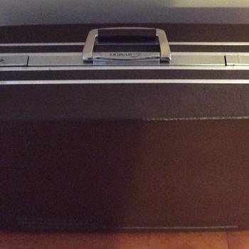 Brown Cavalet luggage.
