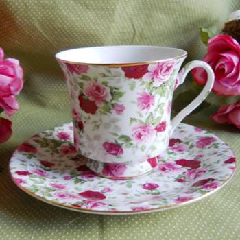 Porcelain tea cup, and saucer set.  - China and Dinnerware