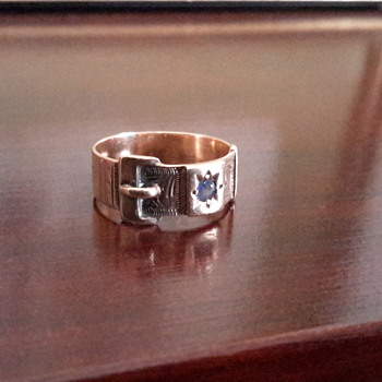 9 ct rose gold buckle ring with sapphire