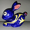 Signed blue Rabbit pottery with handpainted flower