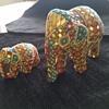 Hand carved?molded? studded elephants.