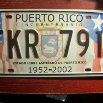 CONTROVERSIAL PUERTO RICO 5OTH ANNIVERSARY LICENSE PLATE FROM 2002 - Signs