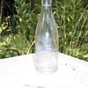 """SPRAY BEER """"TIS PURE"""" clear glass bottle"""