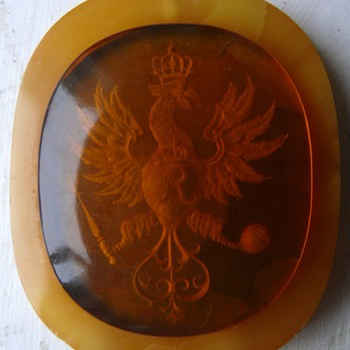 amber thing with ingrained coat of arms