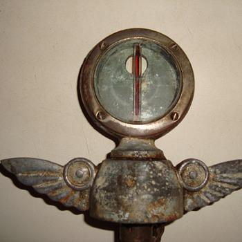 1925   studebaker  hood ornment  with boyce motometer