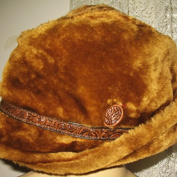 Fuax Fur Hat with tooled leather band identification please