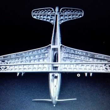 Part 4 - Larry Bell's P-39 Airacobra Diamond and Platinum Brooch - reverse side, openwork, grid, setting. - Advertising
