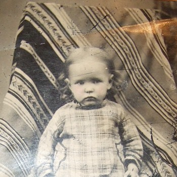 Tintype of child with interesting rug/ blanket backdrop - Photographs