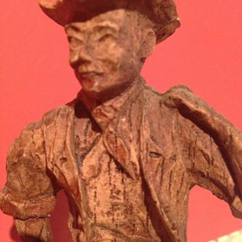 A hand carved wooden cowboy  - Folk Art