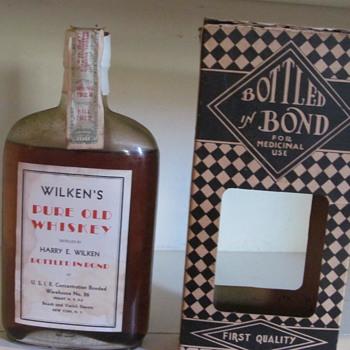 Wilken's Pure Old Whiskey bottle in bond 1924 - Bottles