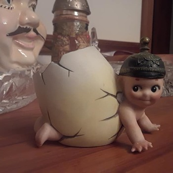 Kewpie soldier coming out of an egg.  - Dolls