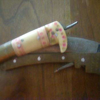 50 + year old folding hand scythe?