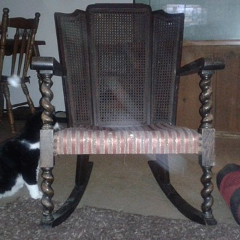 Laura's antique, barley twist rocking chair with vertical ladder & cane back