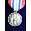 Alaska Territorial Guard 1942-1947 Medal and Ribbons in display case.