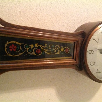 Closer pics of clock. Front of clock. Picture has the writing in the lower right hand corner. - Clocks