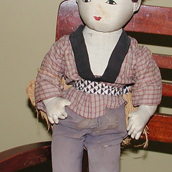Island Boy doll and Japanese Peasant Doll, both hand made and old