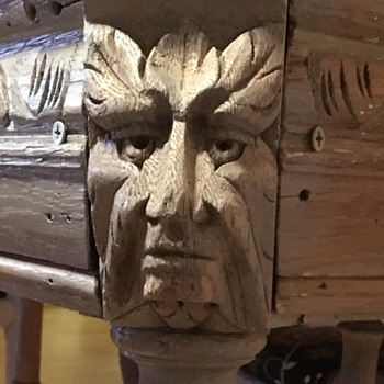 Handmade, carved table, with faces.   - Furniture