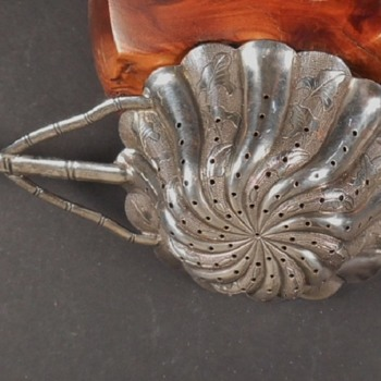 Can anyone interpret the silver mark or pattern on this tea strainer? - Silver