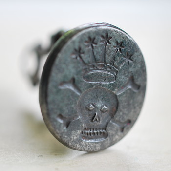 skull and crossbones under a crown antique fob seal - Office