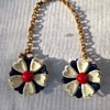 sweater chain with red, white and blue painted metal flowers