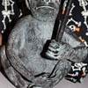 Metal monkey candle holder