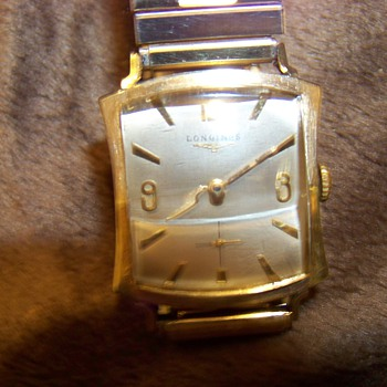 longines notched tank