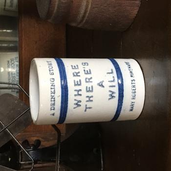 Stoneware Advertising Drinking mug. Unknown history.