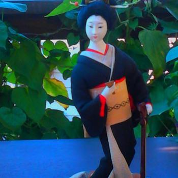 Shamisen player with black kimono