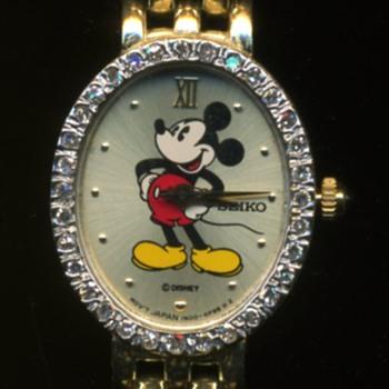 Mickey & Company 14K Gold Woman's Watch Diamonds Around Face - Wristwatches