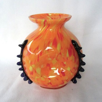 A new Kralik spatter vase in the orange-yellow-red, with black rigaree tooled glass applications, marked - Art Glass