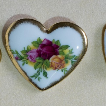 These appear to be a pin and earring set