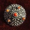 Silver, coral peasant brooch.