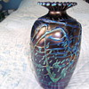 """IRRIDESCENT TUBE LINED GLASS VASE  7"""" HIGH  X 4""""  AT WIDEST PART OF VASE."""