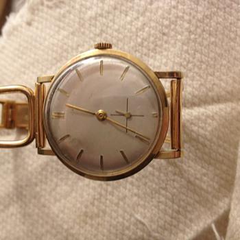 14 k golden watch with golden wrist band