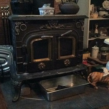 this is an air tight, wood burning, cast iron stove. double doors and 2 handles. fancy design. need help on manufacturer.
