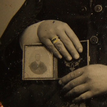 Woman in mourning holds image of her deceased husband - Military and Wartime