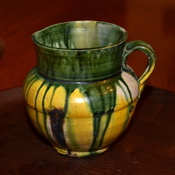 Small pitcher/creamer with drip glaze. - Pottery