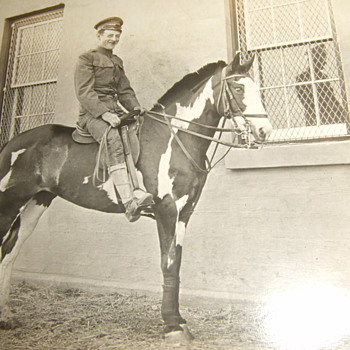 RPPC of early 20th century soldier on horseback - Photographs
