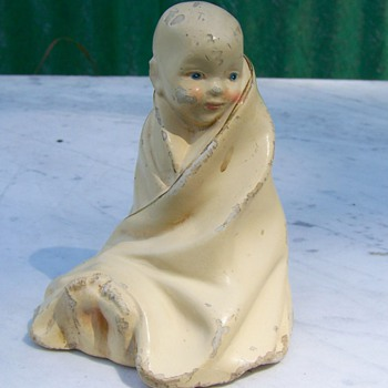 Antique Chalkware Baby Sitting up Wrapped In a Blanket  - Figurines