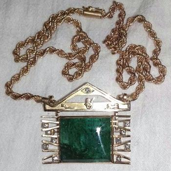 Unique Antique 83ct emerald and diamonds set in a 18k gold pendant brooch