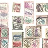 Belgium Documents with cancelled stamps and  several hundred cancelled stamps cut from similiar documents