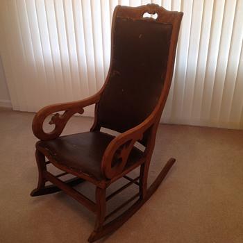 Antique rocker--wood, leather, tack-trimmed
