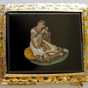 19th Century Micro mosaic Brooch depicting a lady combing her hair set in 18K yellow gold