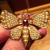 Cute butterfly brooch dated 1898 14k gold, seed pearls and ruby.