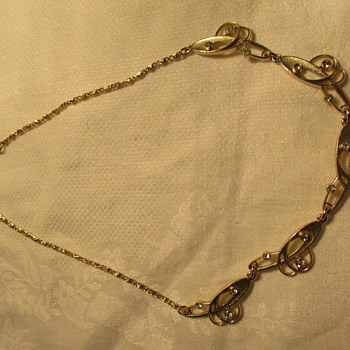 mystery  hallmark or signature  on gold tone necklace