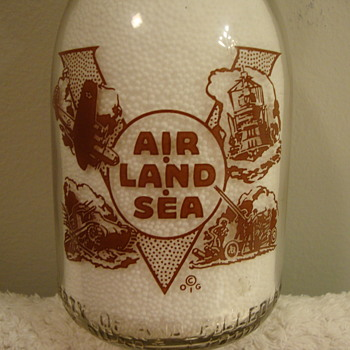 PEERLESS DAIRY...ROCK ISLAND ILLINOIS WAR SLOGAN MILK BOTTLE - Bottles