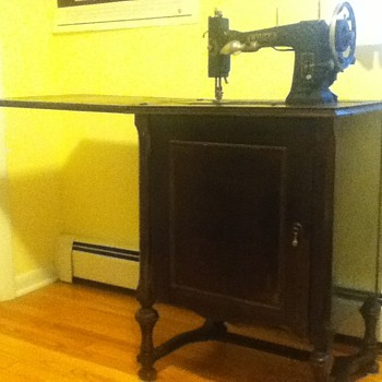 Working antique sewing machine w/cabinet bought at garage sale for a bargain!