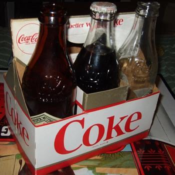 1963 coke cardboard carrier.