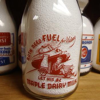 CANADIAN WAR SLOGAN MILK BOTTLE FEATURING A TANK..... - Bottles