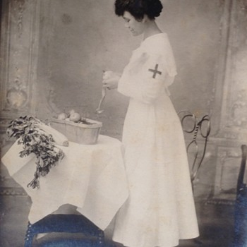 1917 nurse peeling a potato - Photographs